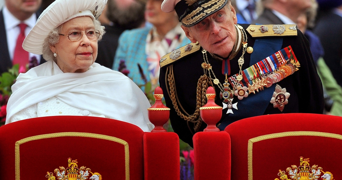 Picture taken on June 3, 2012 shows Britain's Queen Elizabeth (L) and Prince Philip, Duke of Edinburgh, standing onboard the Spirit of Chartwell during the Thames Diamond Jubilee Pageant on the River Thames in London.</p>