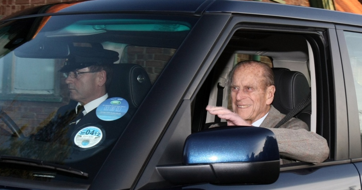 Prince Philip waves as he is driven away from Papworth Hospital in Cambridge, England, on Dec. 27, 2011.</p>
