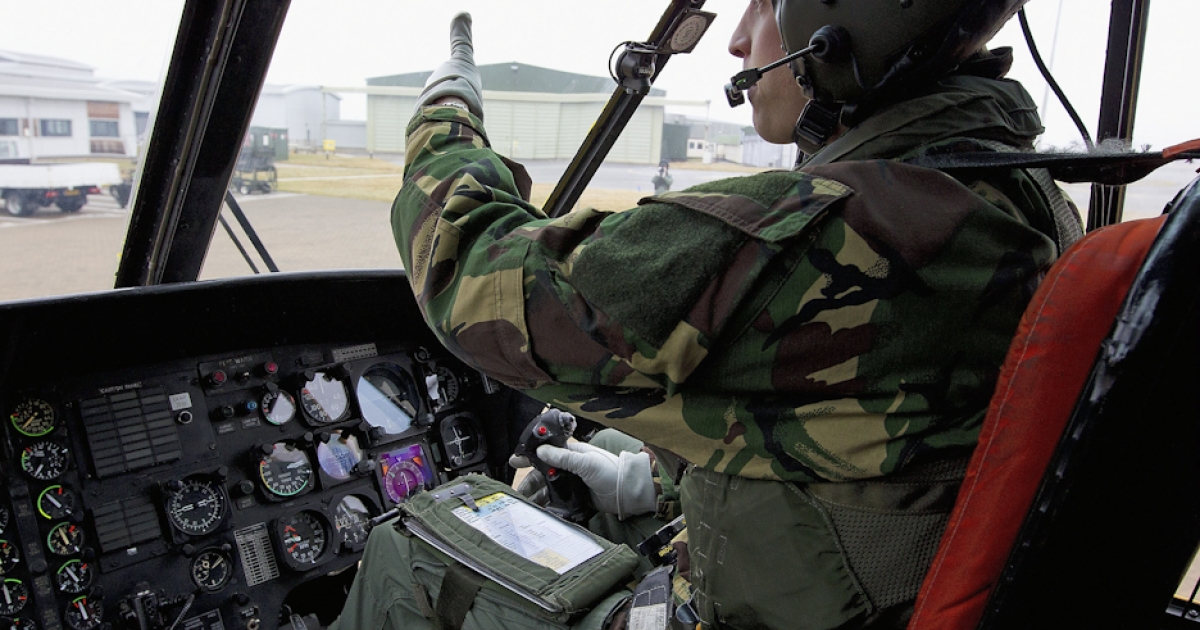 In this image provided by the Ministry of Defence, Prince William takes the controls of a Sea King helicopter on April 14, 2011 in Holyhead, Wales. Search and rescue co-pilot Prince William, based at RAF Valley will marry his fiancee Catherine Middleton in Westminster Abbey in London on April 29, 2011.</p>