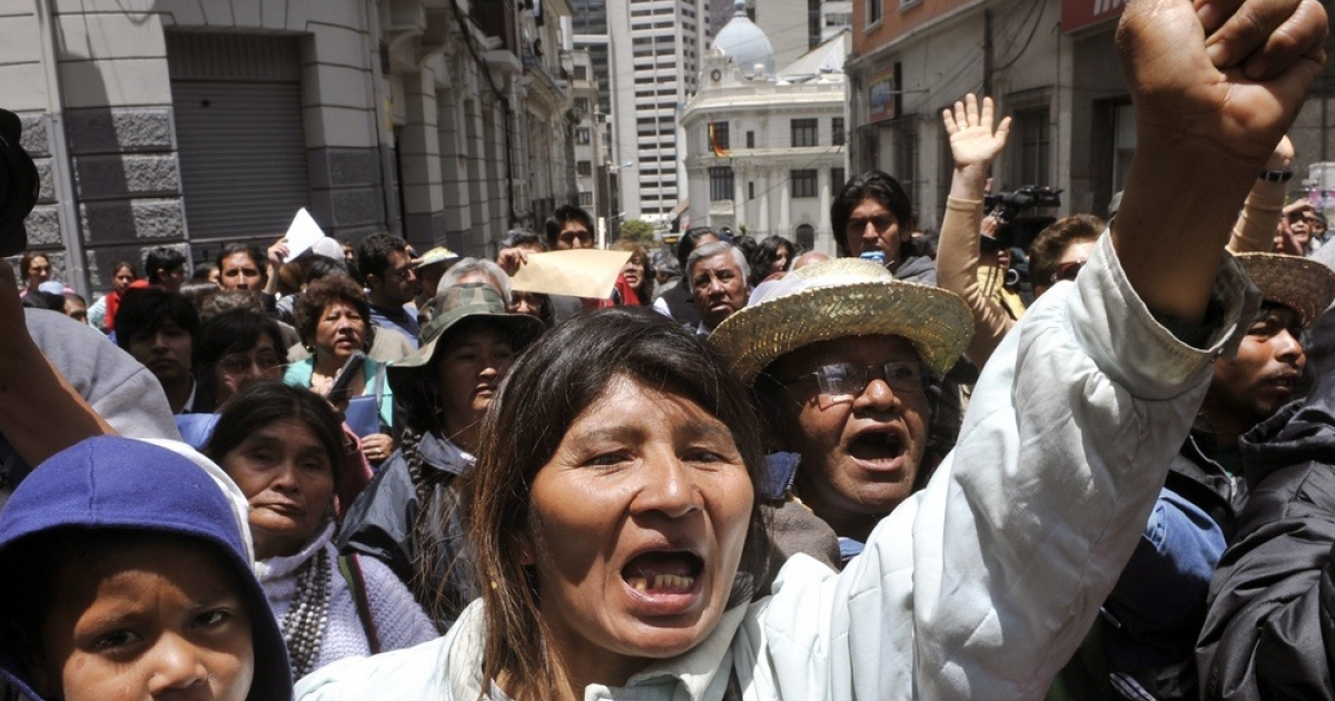 Demonstrators march against a planned road through the Amazon.</p>