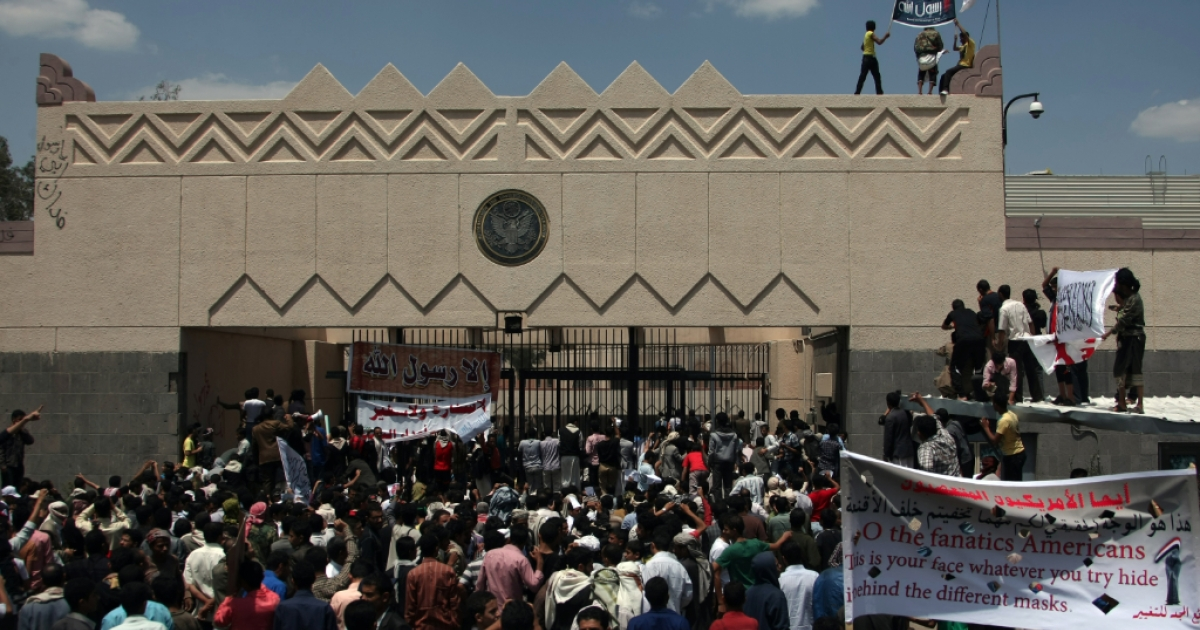 The United States will reopen most of its diplomatic posts on Sunday but not the US Embassy in Yemen. Yemeni protesters try to break through the gate of the US embassy in Sanaa on September 13, 2012.</p>