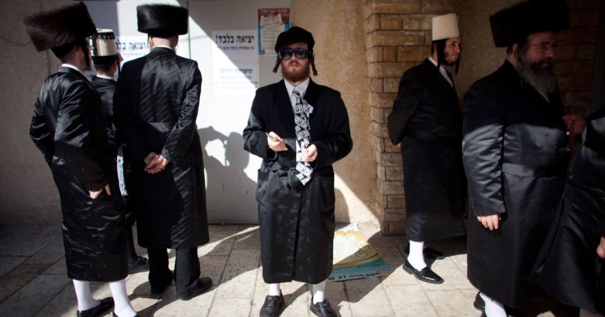 Ultra Orthodox Jews celebrate the Jewish holiday of Purim on March 8, 2012 in Benei Brak, Israel. The carnival-like Purim holiday is celebrated with parades and costume parties to commemorate the deliverance of the Jewish people from a plot to exterminate them in the ancient Persian empire 2,500 years ago, as described in the Book of Esther.</p>