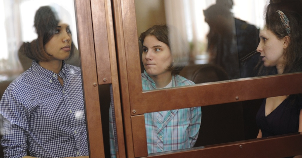 Members of the all-girl punk band 'Pussy Riot.' Nadezhda Tolokonnikova (L), Maria Alyokhina (R) and Yekaterina Samutsevich (C), sit during a court hearing in Moscow on July 30, 2012. In February, five women walked silently into Moscow's Church of Christ the Saviour before clambering over railings, pulling on balaclavas, and singing out a protest song against Vladimir Putin. The three have already spent four months in jail awaiting trial .</p>