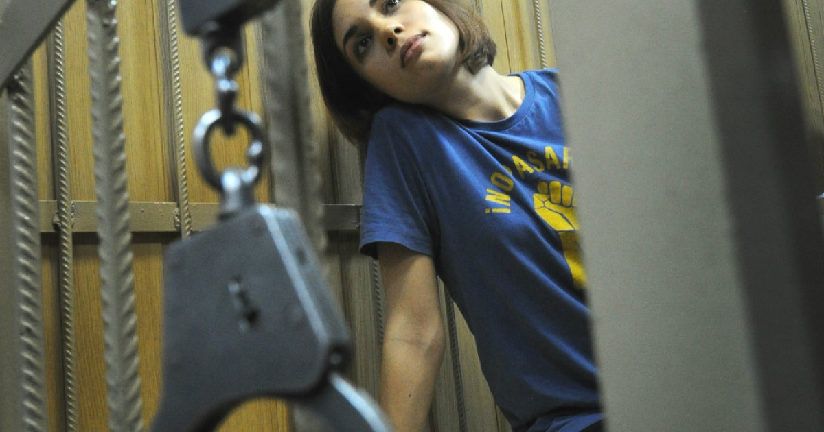 Nadezhda Tolokonnikova, a member of female Russian punk band Pussy Riot, sits inside a defendants cage in a Moscow court during the hearings on the Pussy Riot case.</p>