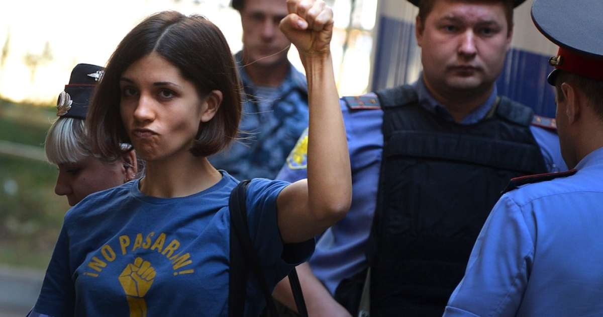 Pussy Riot member Nadezhda Tolokonnikova raises her first before a court hearing in Moscow on August 8, 2012.</p>