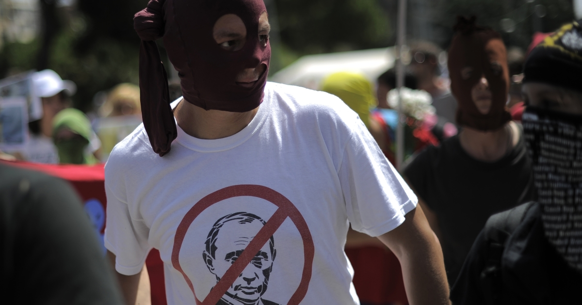 A Pussy Riot supporter in Spain. Sentencing the band's members may appear illogical abroad, but Putin came to power cracking down on critics.</p>