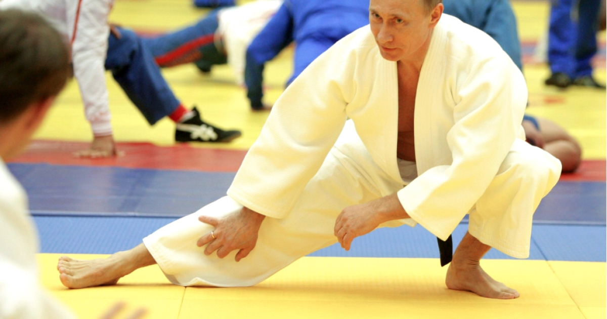 Russia's Prime Minister Vladimir Putin takes part in a judo training session at the 'Moscow' sports complex in St. Petersburg, on December 22, 2010.</p>