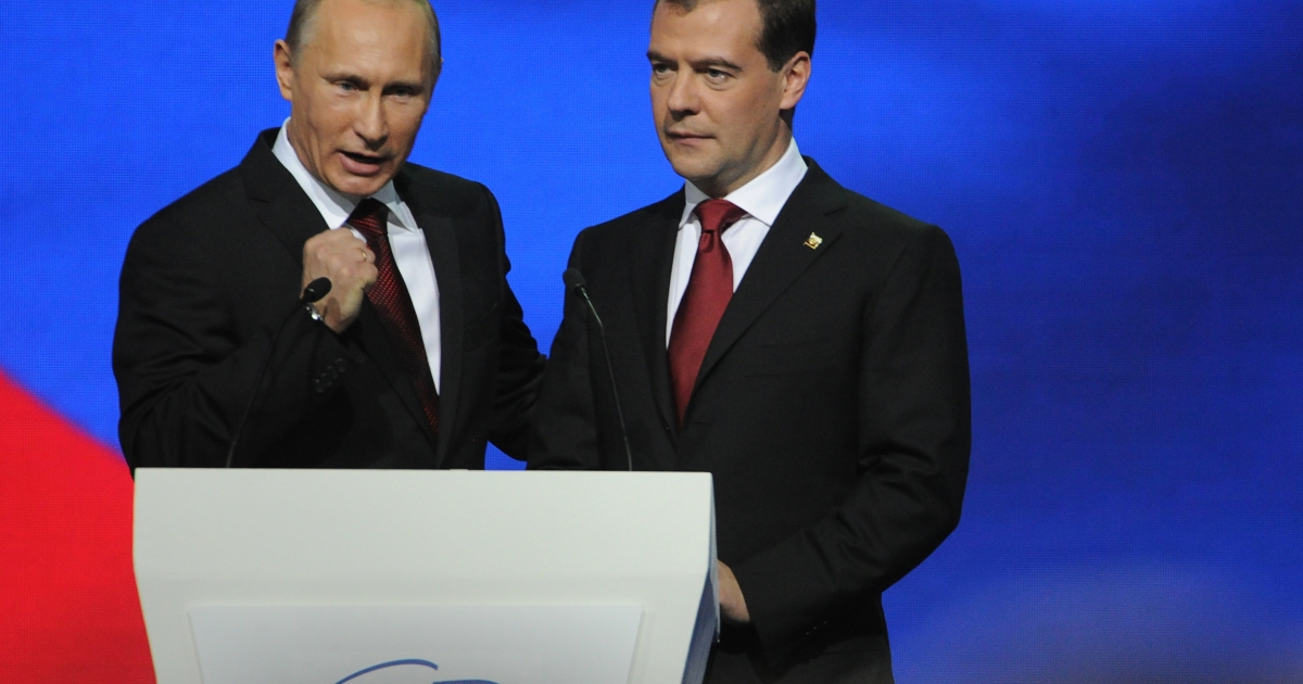 Russian President Dmitry Medvedev (R) and Prime Minister Vladimir Putin address United Russia party delegates in Moscow on Nov. 27, 2011. Prime Minister Vladimir Putin accepted the ruling United Russia party's nomination to run for president in elections in March 2012 and regain a post he held in 2000-2008.</p>