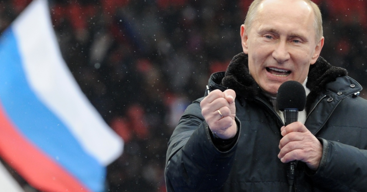 Putin, drumming up support at a recent rally.</p>