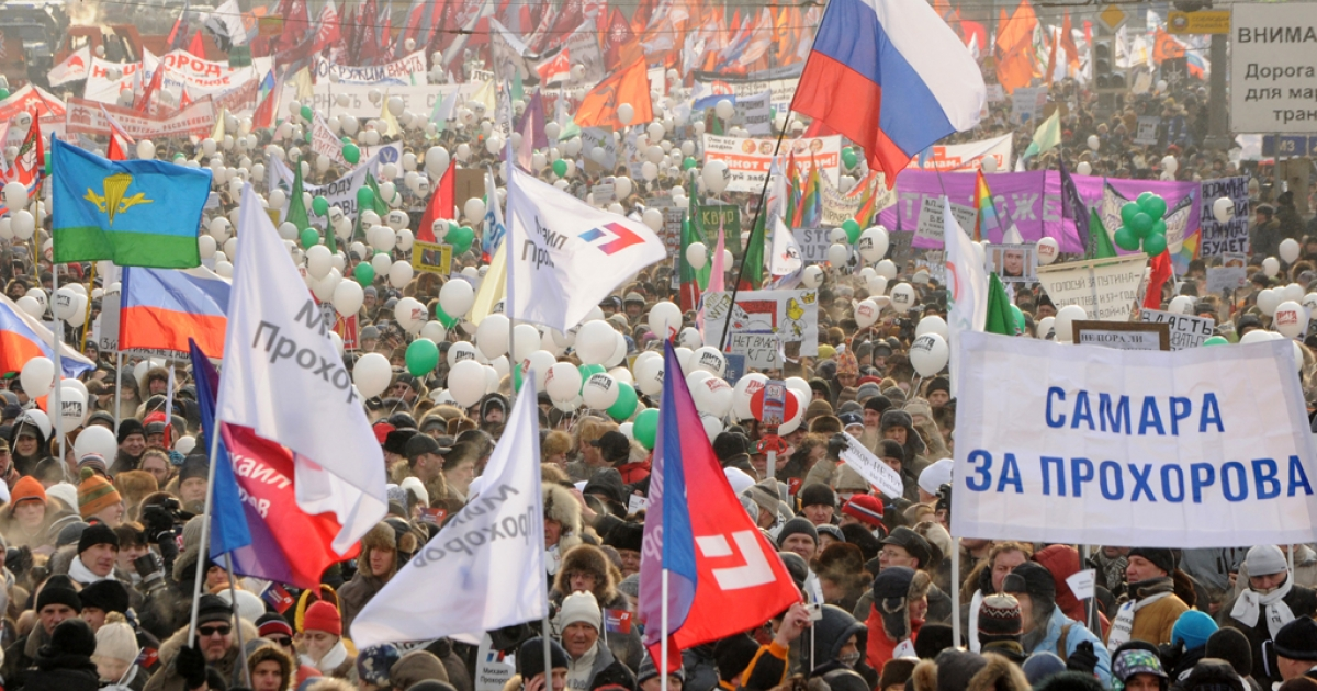 Pollsters predict Prime Minister Vladimir Putin will win the first round of the March 4 election for the presidency with more than half the vote, even as the opposition continues to hold rallies in protest. In this picture, from February 4, 2012, people rallied in central Moscow to urge Putin to quit power. One of the posters reads:
