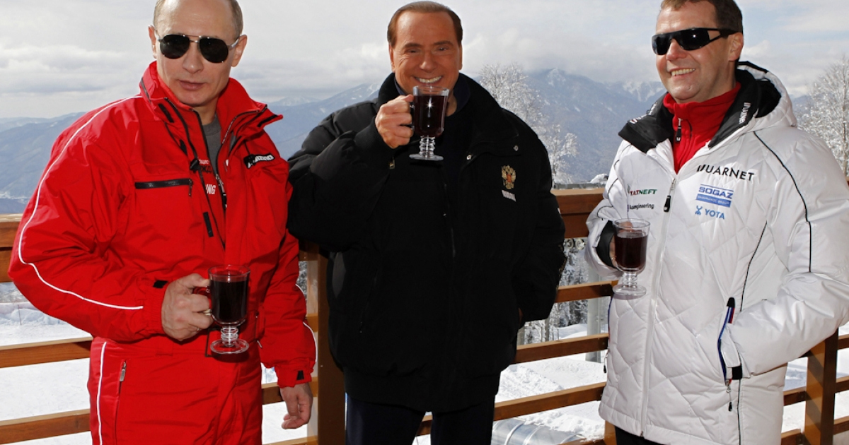 Russia's outgoing President Dmitry Medvedev (R) and newly elected president Vladimir Putin (L) meet with former Italy's Prime minister Silvio Berlusconi at the Rosa Khutor apline ski resort in Krasnaya Polyana, some 30 miles from Sochi, on March 8, 2012. Italy's ex-prime minister Silvio Berlusconi flew into Russia for a lavish dinner with Vladimir Putin after his old ally's victory in presidential elections, state television said.</p>