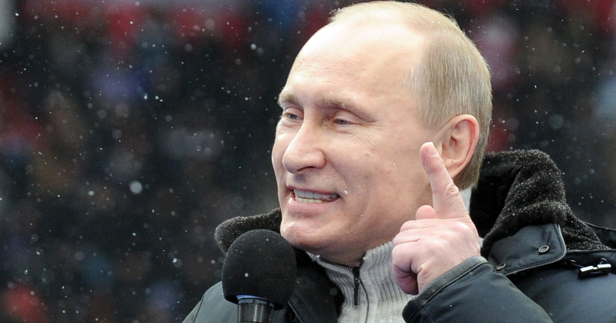 Vladimir Putin delivers a speech on Thursday during a rally with his supporters at Luzhniki Stadium in Moscow.</p>