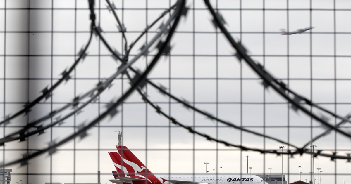 Qantas airline jets sit grounded on the tarmac at Heathrow airport on October 30, 2011 in London, England.</p>