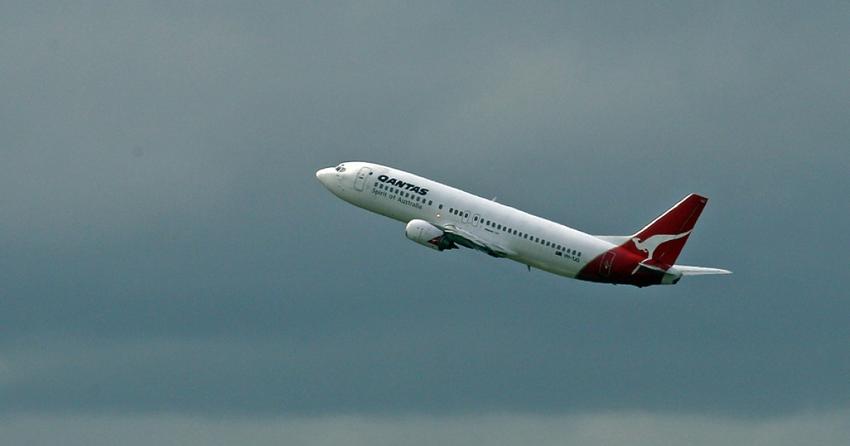 A Qantas airplane takes off at Melbourne Airport on October 31, 2011 in Melbourne, Australia.</p>