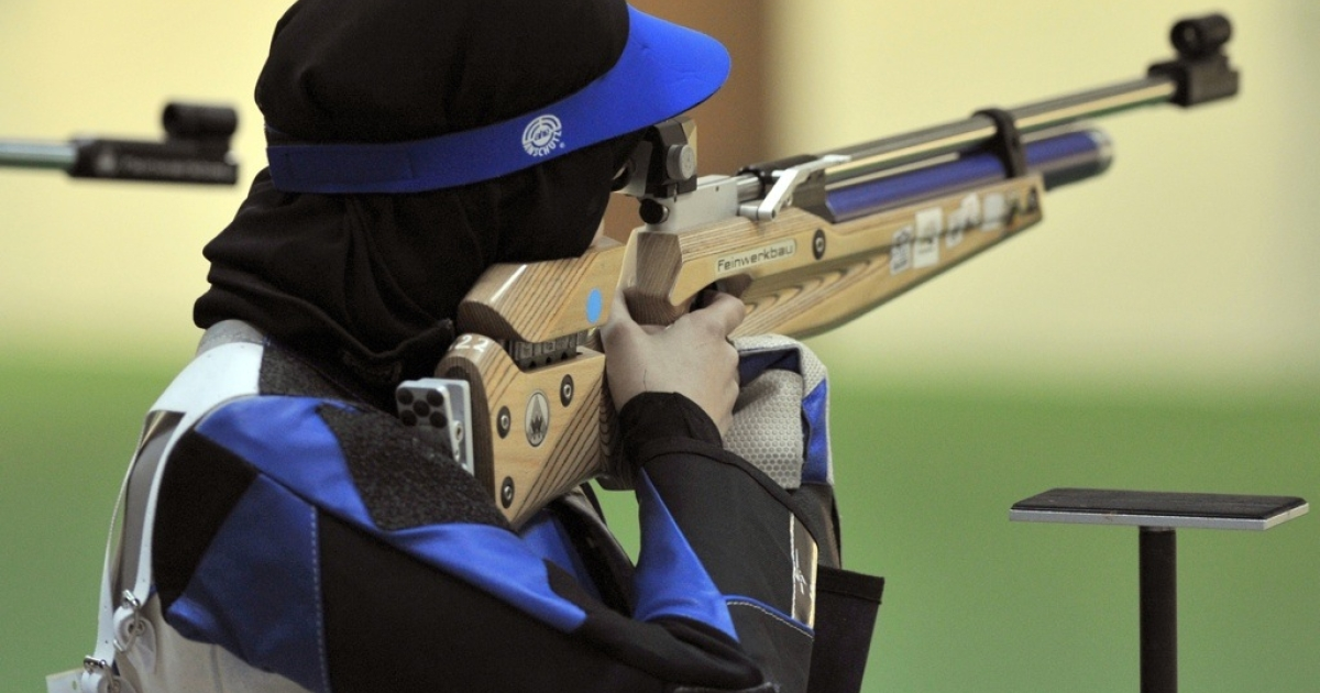 Kuwaiti Ayat al-Duwaikhi competes in the women's air rifle competition at the Lusail Shooting Complex in Doha during the 2011 Arab Games in Qatar on December 11, 2011.</p>