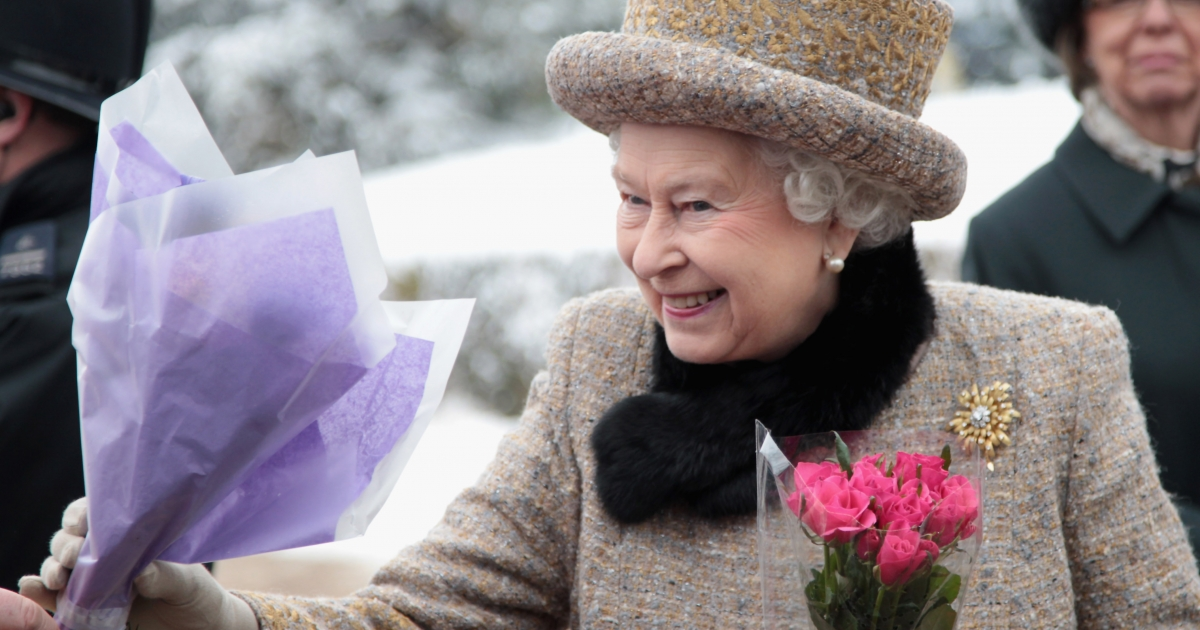 Queen Elizabeth II is handed flowers as she leaves the Sunday Service at West Newton Church on February 5, 2012 in King's Lynn, England. Monday, Accession Day, will mark six decades since she took the throne in 1962.</p>