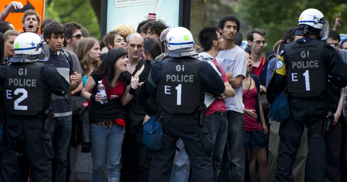 Protesters argue with police outside  a reception for the Montreal Grand Prix on June 7, 2012. Riot police in Montreal arrested more than 20 demonstrators outside a Formula 1 reception.</p>
