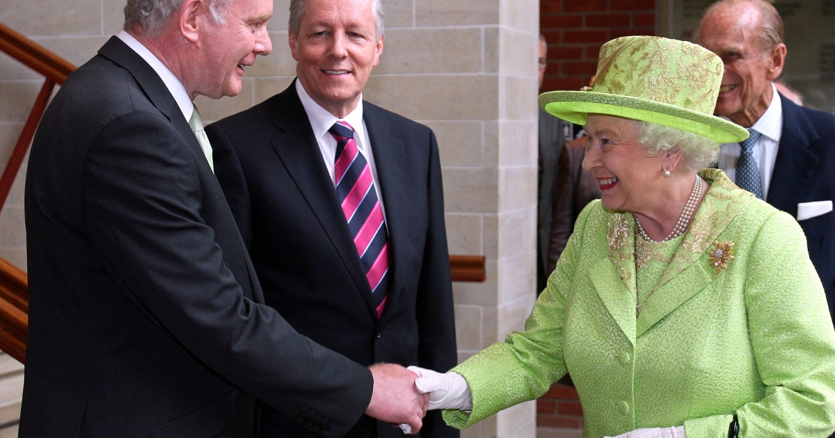 Britain's Queen Elizabeth II (2nd R) shakes hands with Northern Ireland Deputy First Minister Martin McGuinness (L) watched by First Minister Peter Robinson (2nd L) and Prince Philip (R) at the Lyric Theatre in Belfast, Northern Ireland, on June 27, 2012.</p>