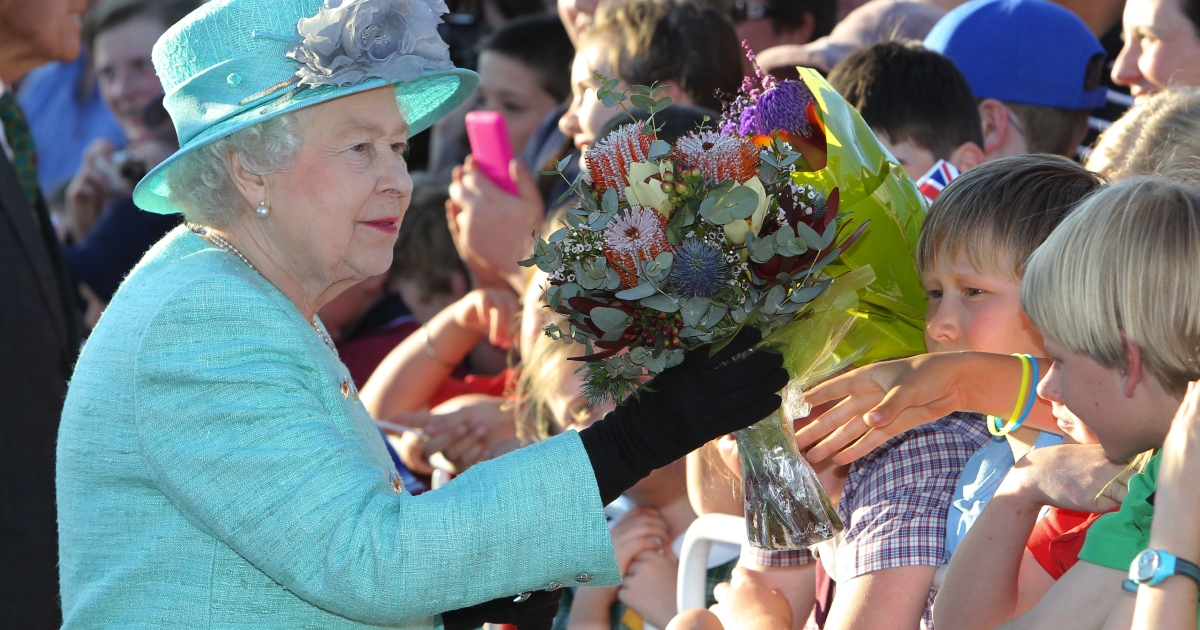 Queen Elizabeth II receives gifts from the crowd on arrival at Fairbairn base on October 19, 2011 in Canberra, Australia. The Queen and Duke of Edinburgh are on a 10-day visit to Australia and will travel to Canberra, Brisbane, Melbourne before heading to Perth for the Commonwealth Heads of Government meeting. This is the Queen's 16th official visit to Australia.</p>