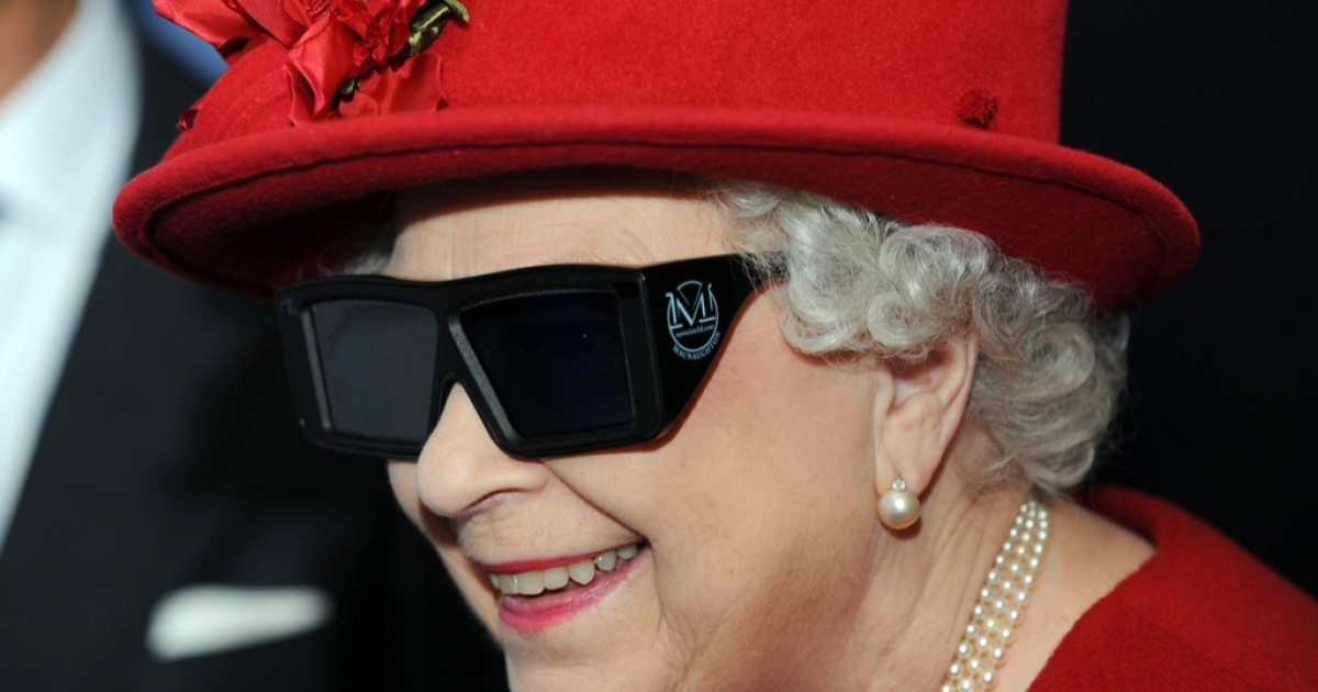Queen Elizabeth II wears 3 D glasses to watch a display and pilot a JCB digger, during a visit to the University of Sheffield Advanced Manufacturing Research centre, on November 18, 2010 in Sheffield, England.</p>