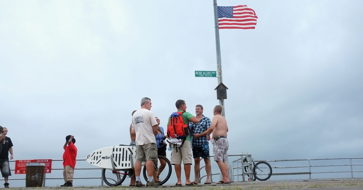 Tourists stand along the boardwalk in the Rockaways, in the Queens borough of New York.</p>