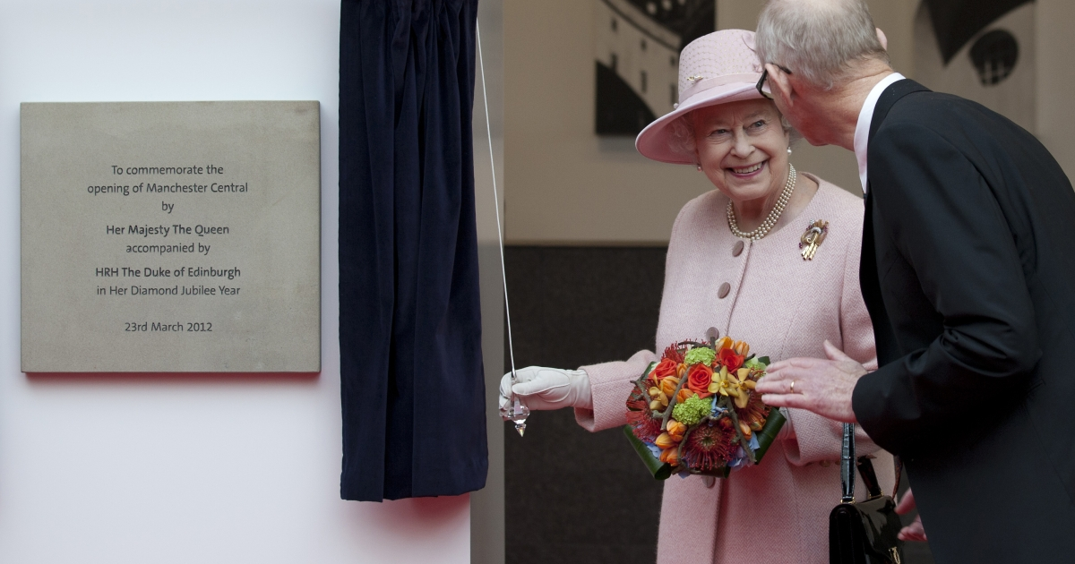 Queen Elizabeth II smiles after unveiling a plaque during her visit to the Manchester Central convention center on Thursday.</p>