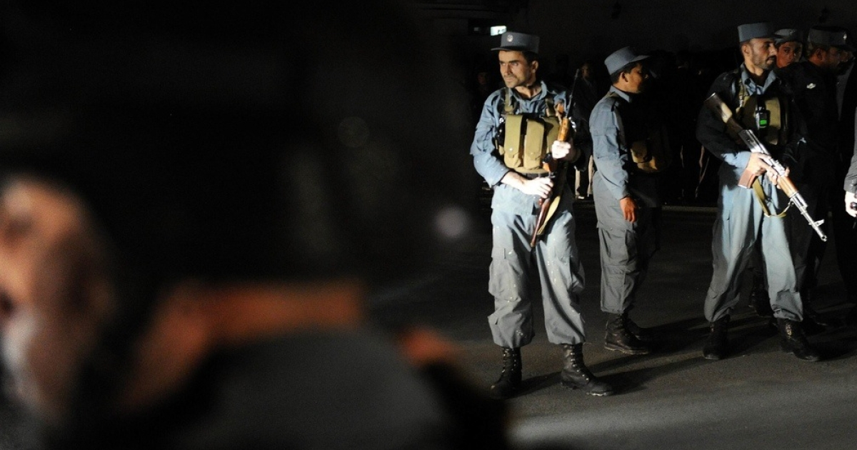 Afghan police stand guard outside Rabbani's home after his assassination.</p>