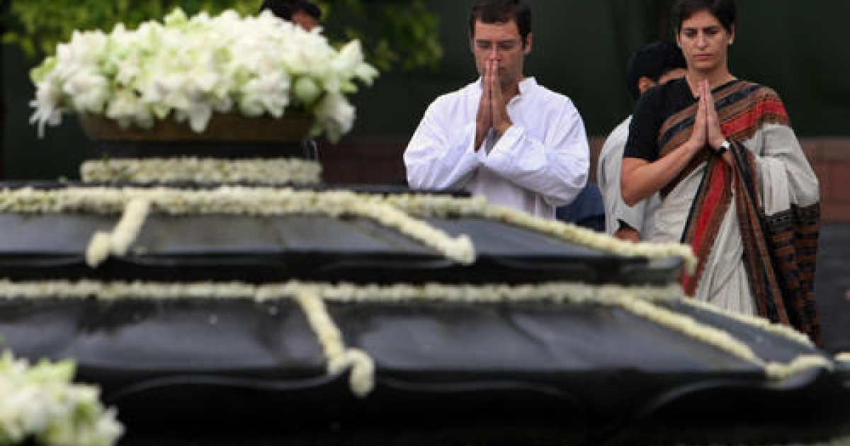 Daughter of India's Congress Party President Sonia Gandhi, Priyanka Gandhi-Vadhera (R) prays along with her brother Rahul Gandhi at the cremation site and memorial to their father and slain former Indian premier Rajiv Gandhi in New Delhi on May 21, 2008 marking the 17th death anniversary of the assassinated leader.  Rajiv Gandhi was assassinated 21 May 1991 in Tamil Nadu by Liberation Tigers of Tamil Eelam (LTTE) activists.</p>