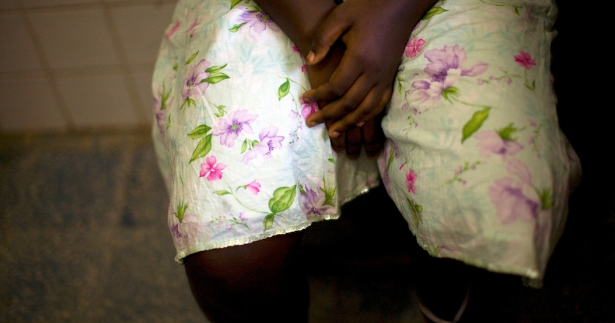 A 15-year-old woman seeking medical treatment waits at the Doctors Without Boarders (MSF) clinic in Monrovia on November 30, 2009, after being raped.</p>