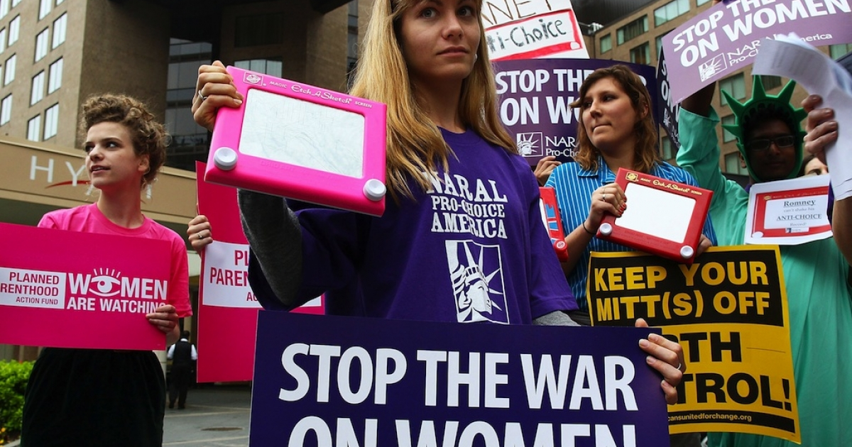 NARAL policy aide Kate Vlach participates in a protest outside of the Hyatt Regency where Republican presidential candidate, former Massachusetts Gov. Mitt Romney was scheduled to attend a fundraiser on March 22, 2012 in Washington, DC. John Koster is the latest Republican politician to draw criticism over his comments on rape and abortion.</p>