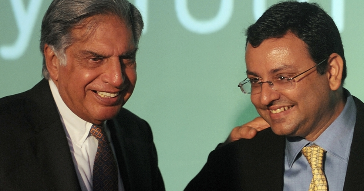 Tata Sons chairman, Ratan Tata (L) interacts with deputy chairman of Tata Sons, Cyrus Mistry during a function to launch the new Croma e-retail store, in Mumbai on April 23, 2012. Tata, now 75, announced his retirement on December 28, 2012, passing the reins to Mistry.</p>