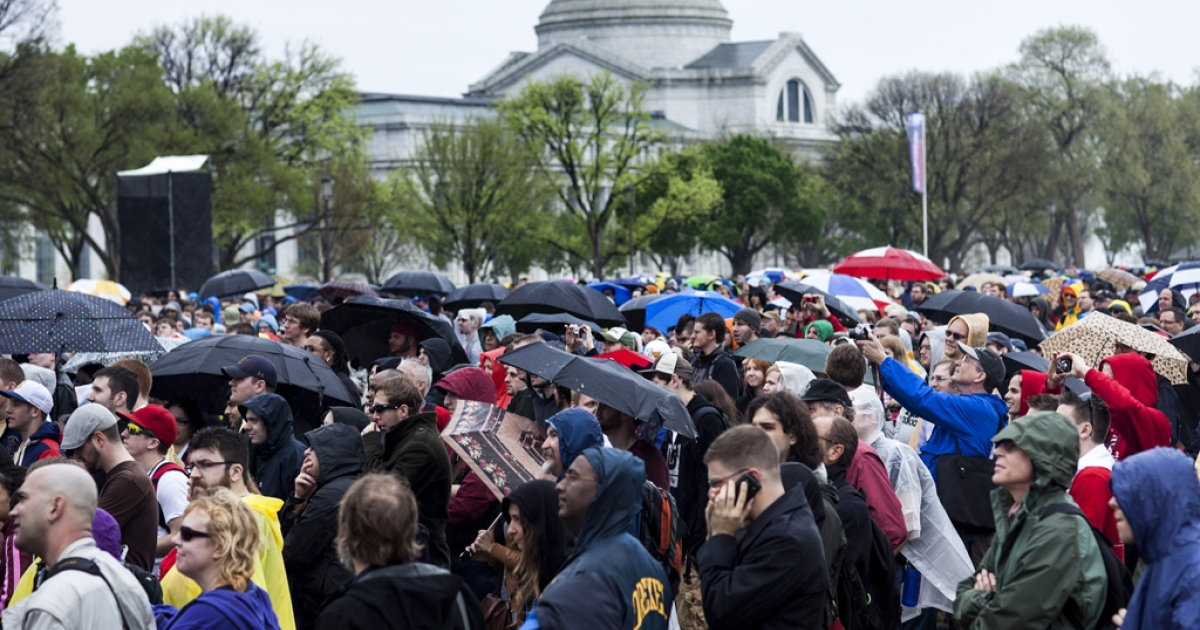 People listen during the Reason Rally on the National Mall March 24, 2012 in Washington, DC. Atheist group IHEU has submitted a document to the United Nations, claiming that non-believers face persecution worldwide.</p>
