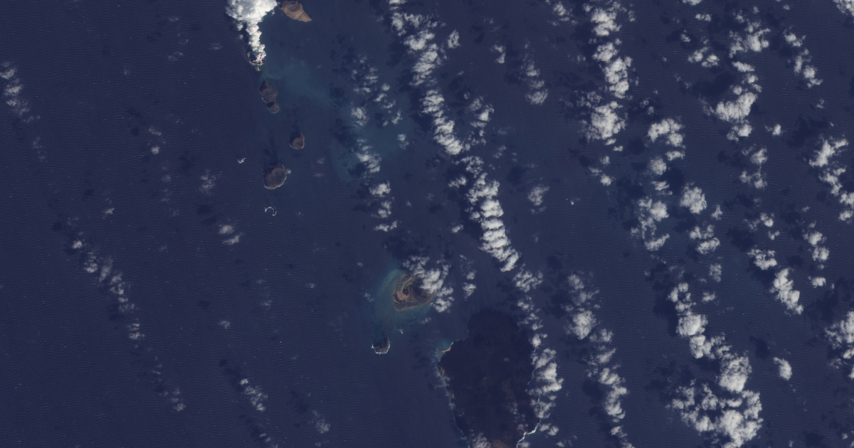 An image taken by NASA's Earth Observing-1 (EO-1) satellite on Dec. 23, 2011, shows an island, with a thick plume rising from it, where there had previously been an unbroken water surface.</p>
