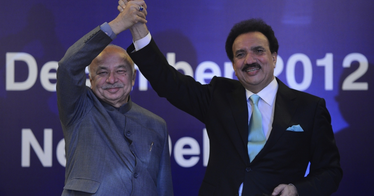 Interior Minister of Pakistan Rehman Malik (R) shakes hands with Indian Home Minister Sushilkumar Shinde during the launch of new visa agreement in New Delhi on December 14, 2012. Days later, Malik scuttled any goodwill built on his visit.</p>