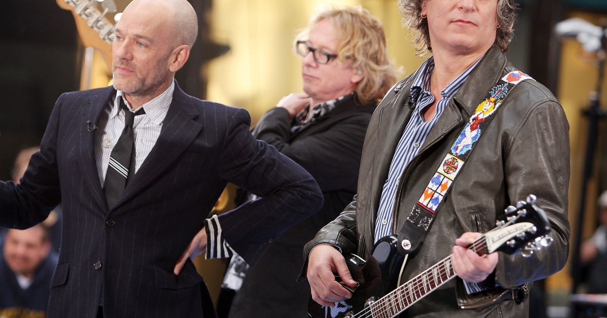 Michael Stipe, Mike Mills, and Peter Buck of R.E.M. perform during the NBC 'Today' show concert series at Rockefeller Center on April 1, 2008 in New York City.</p>