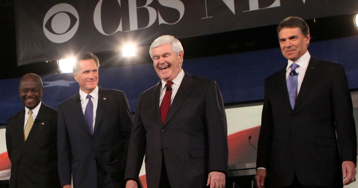 Republican presidential candidates (L-R) businessman Herman Cain, former Massachusetts Governor Mitt Romney, former Speaker of the House Newt Gingrich (R-GA), and Texas Governor Rick Perry stand on the stage prior to a presidential debate on Nov. 12, 2011, in Spartanburg, S.C.</p>