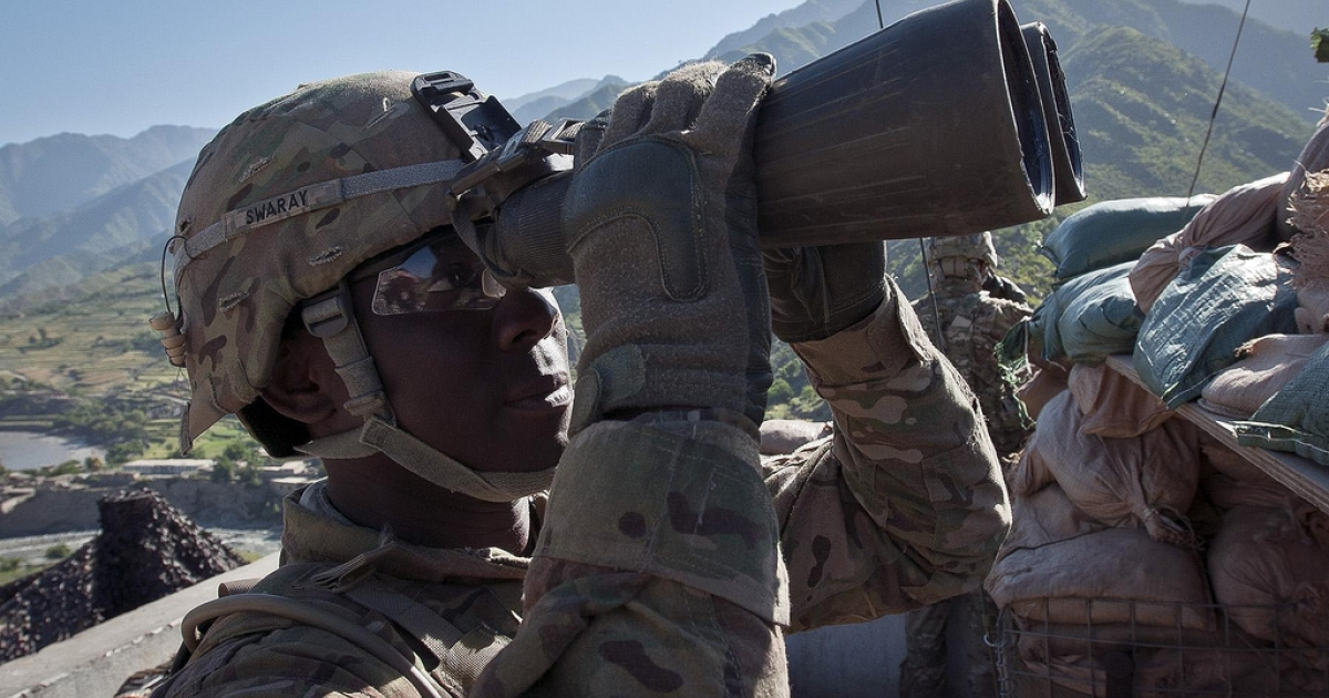 U.S. Army Pfc. William A. Swaray, an infantryman and native of Monrovia, Liberia, assigned to Company B, 2nd Battalion, 27th Infantry Regiment, Task Force No Fear, 3rd Brigade Combat Team, 25th Infantry Division, TF Bronco, scans for insurgent activity at Observation Post Coleman outside of Combat Outpost Monti in eastern Afghanistan's Kunar Province, on May 5, 2011.</p>
