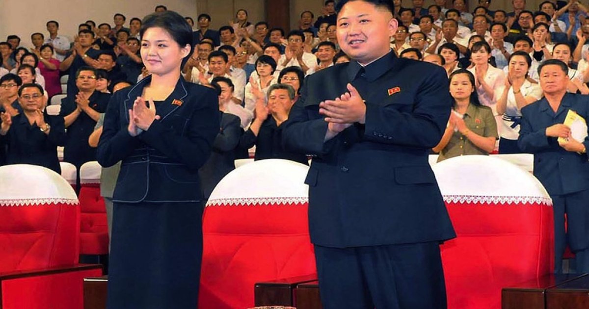 Kim Jong Un stands with his wife, Ri Sol Ju.</p>