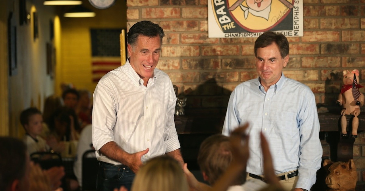Republican presidential candidate Mitt Romney and US Senate Candidate Richard Mourdock (R-IN) (R) greet supporters at a campaign event at Stepto's Bar B Q Shack on August 4, 2012 in Evansville, Indiana.</p>