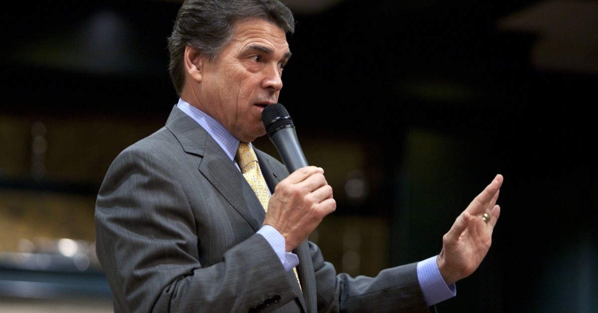 Republican presidential candidate and Texas Gov. Rick Perry speaks to local residents at the 'We the People: A First in the Nation Freedom Forum' town hall event at the One Liberty Lane Conference Center on October 1, 2011, in Hampton, N.H.</p>