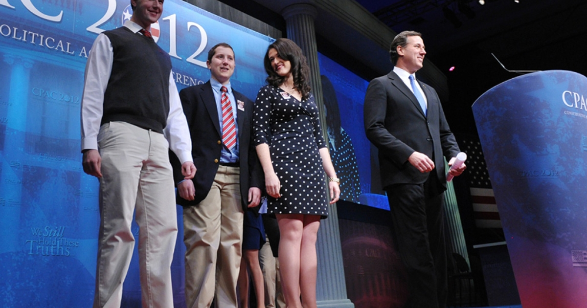 Presidential candidate Rick Santorum arrives on stage with his family to address the 39th Conservative Political Action Committee today in Washington.</p>