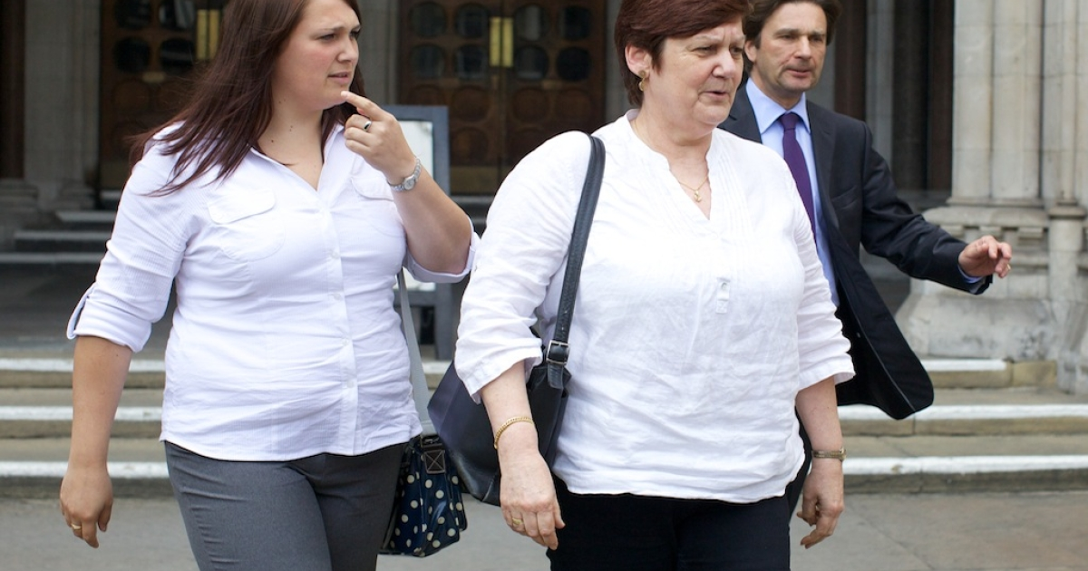 (L-R) Beth and Jane Nicklinson, daughter and wife of Tony Nicklinson who suffers from locked-in syndrome, leave the High Court in Central London on July 19, 2012, after a hearing in Tony Nicklinson's legal bid for the right to end his life when he chooses. Nicklinson wants a doctor to be able lawfully to end his life without fear of prosecution. Nicklinson suffered a catastrophic stroke in 2005, which left him paralysed below the neck and unable to speak. He now communicates by blinking or with limited head movement.</p>