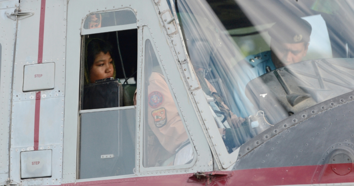 Rimsha Masih, a Christian girl accused of blasphemy sits in helicopter after her release from jail in Rawalpindi on September 8, 2012. Masih was arrested on August 16 for allegedly burning pages containing verses from the Koran but she was released from a prison in Rawalpindi after a court accepted her bail application.</p>