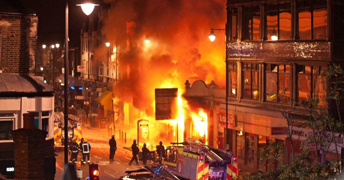 Buildings burn on Tottenham High Road, London after youths protested against the killing of a man by armed police in an attempted arrest, August 6, 2011 in London, England. Twenty-nine-year-old father-of-four Mark Duggan died August 4 after being shot by police in Tottenham, north London.</p>