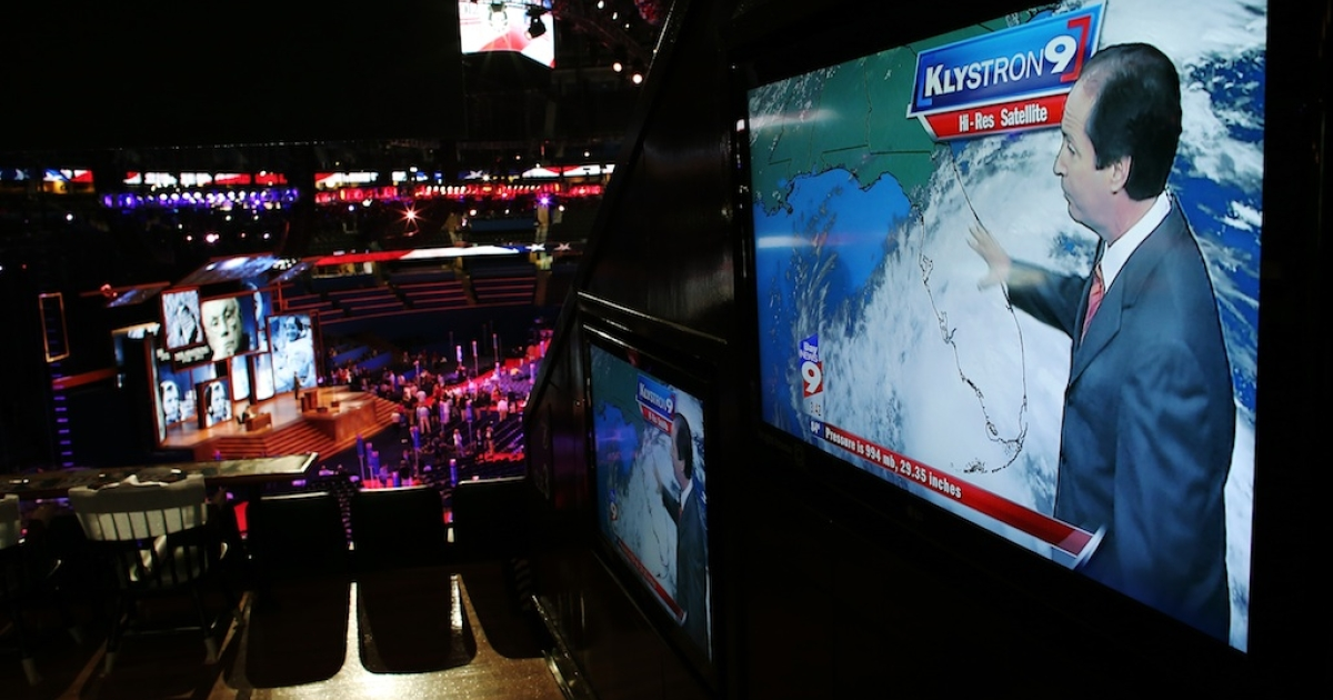 News reports for Tropical Storm Isaac appear on screens ahead of the Republican National Convention at the Tampa Bay Times Forum on August 26, 2012 in Tampa, Florida. The RNC is scheduled to convene on August 27 and will hold its first session on August 28 as Tropical Storm Isaac threatens disruptions due to its proximity to the Florida peninsula.</p>