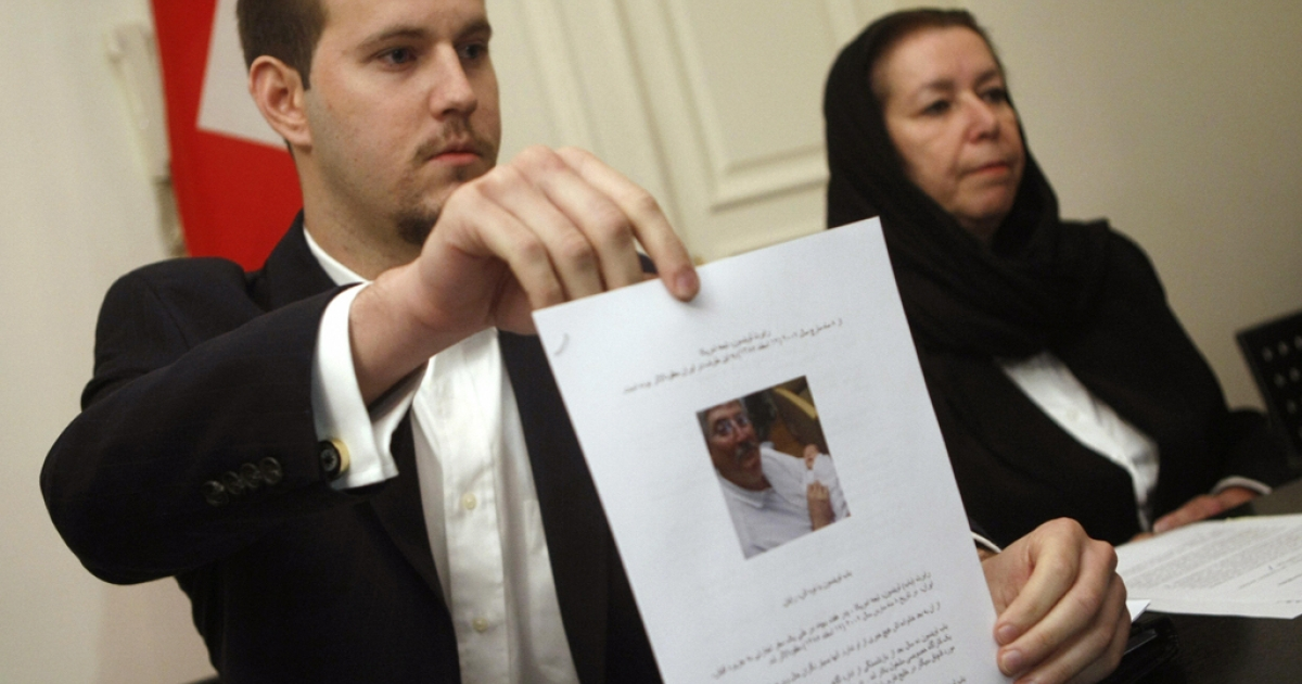 Robert Levinson's son, Daniel, holds a picture of his father during a press conference with his mother at the Swiss embassy in Tehran. The former FBI agent has been missing for nearly five years. The family released a hostage video of him today online.</p>