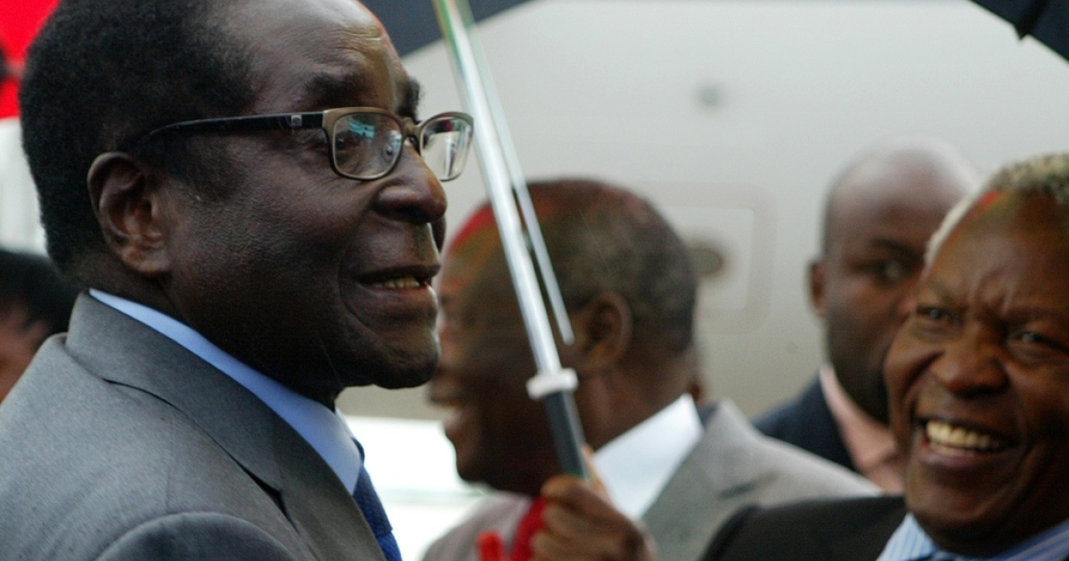 Zimbabwean President Robert Mugabe, 88, chats with State Security Minister Sydney Sekeramayi on April 12, 2012 upon his arrival at the Harare international airport from Singapore following a two-week absence, which sparked reports that he was battling for life in a hospital in the city-state.</p>