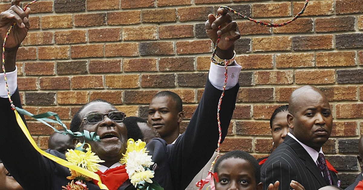 Zimbabwean President Robert Mugabe frolics with balloons on his birthday in 2010. Mugabe, who's been in power since 1980, will turn 89 on Feb. 21, 2013.</p>