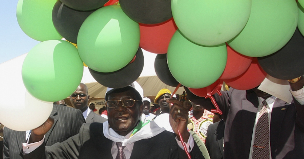 Mugabe with balloons in the colors of his political party, ZANU-PF, at 84th birthday celebrations in Beitbridge. Mugabe appears unconcerned with the prospect of world helium shortages.</p>