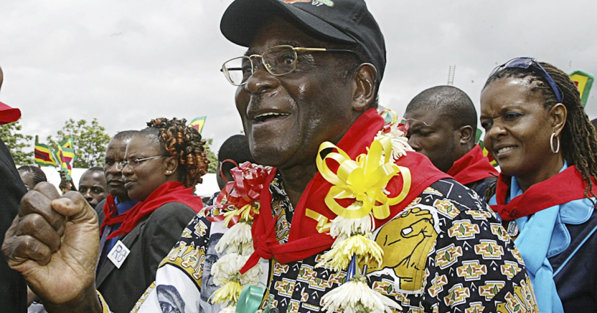 Mugabe goes for a trendy boho layered look on his 83th birthday in 2007, with a patterned shirt, flower lei and red communist-style neckerchief. This was the year that shops in Zimbabwe ran out of bread on Mugabe's birthday.</p>